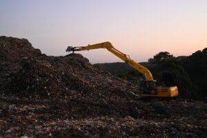 photo of backhoe on landfill
