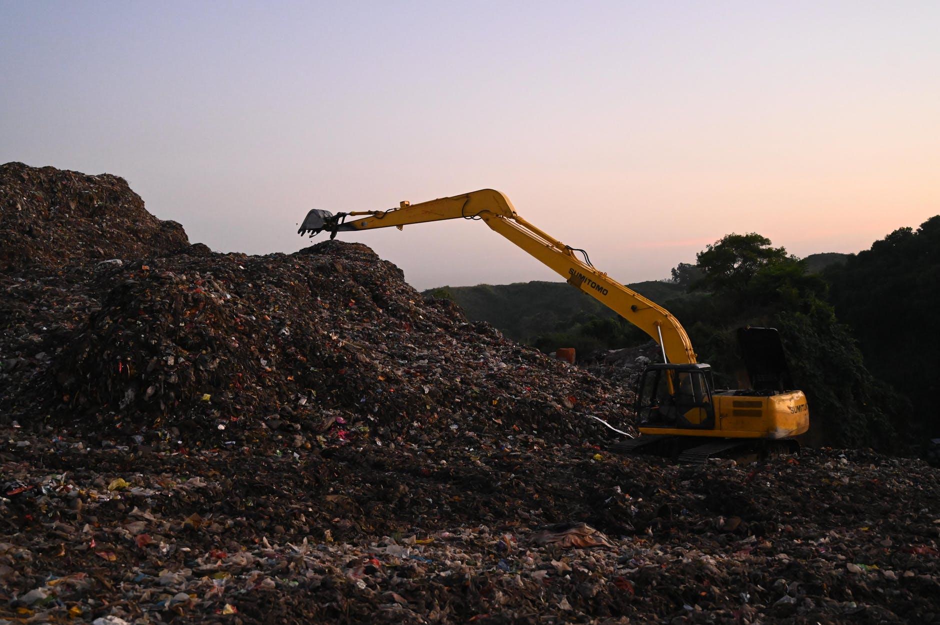photo of backhoe on landfill